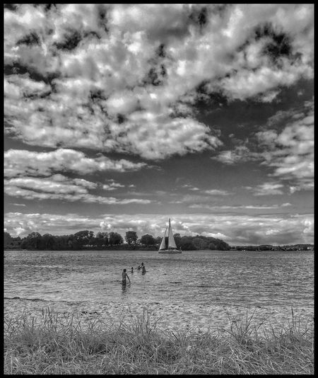 Showcase July Blackandwhite IPhoneography Summer Coastline Denmark Beach Hanging Out Summertime Cloud_collection  Clouds And Sky Coastal_collection Water_collection Sky And Water Childhood Memories Fine Art Photography Boys Sky And Clouds Beachphotography Taking Photos Enjoying Life Relaxing Hanging Out From My Point Of View Clouds