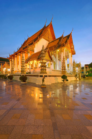 Wat Suthat at Sunset, Bangkok, Thailand Reflection Wat Suthat Architecture Built Structure Day Gold Colored History King - Royal Person No People Outdoors Place Of Worship Religion Sculpture Sky Spirituality Statue Sunset Temple Travel Destinations
