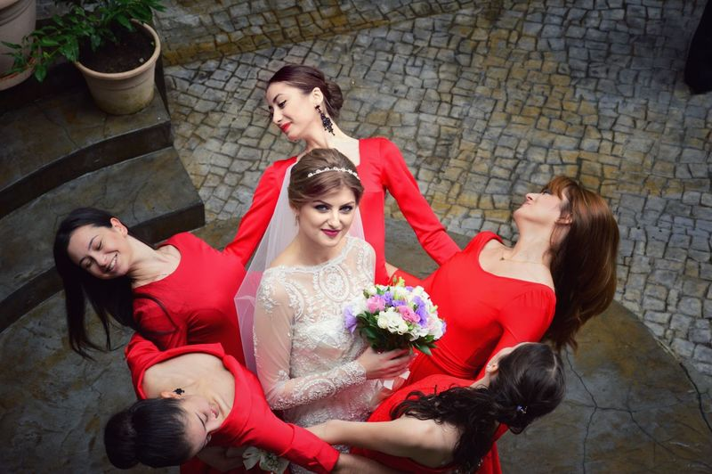High angle portrait of bride standing amidst bridesmaids