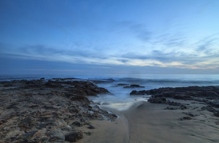 Sunset over the rocks at Shaws Cove in Laguna Beach as water flows over the stone Beach Beach Life Beauty In Nature California Cloud - Sky Coastline Day Horizon Over Water Horizontal Laguna Beach Landscape Nature No People Outdoors Sand Scenics Sea Shaws Cove Sky Sunset