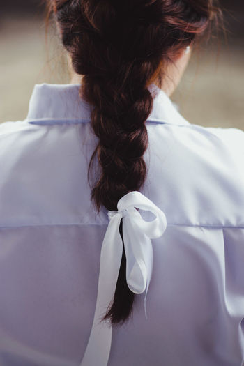 Rear View Of Woman Hair Tied With Ribbon