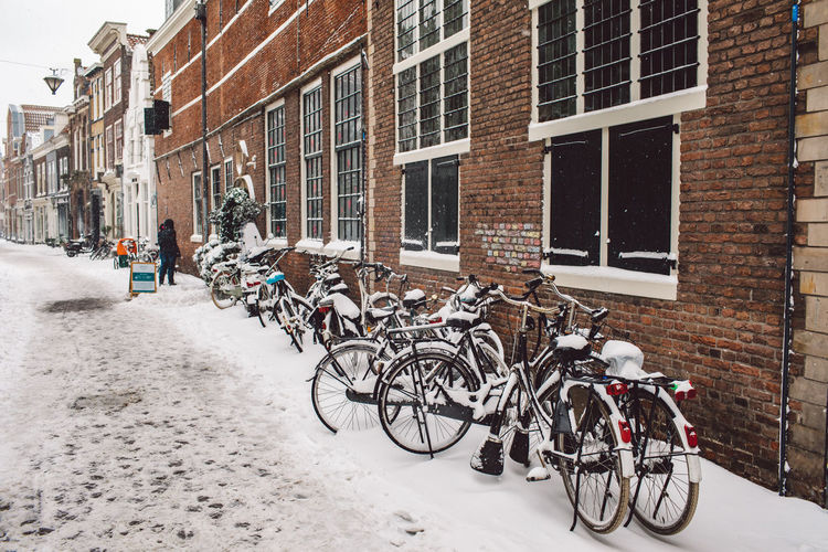 Bicycles on street by building in city