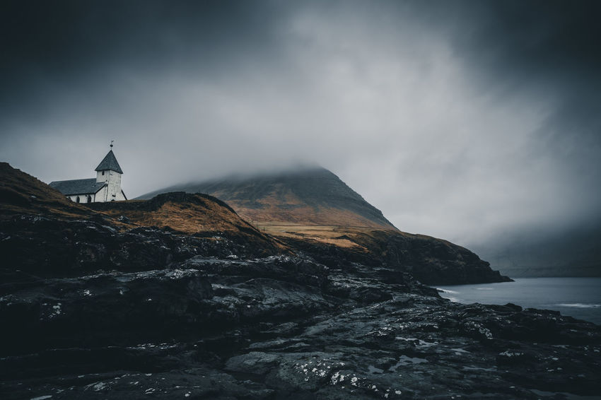 The famous church on the coast of Viðareiði was built in 1892. The old church was destroyed during a storm in the 17th century. The coastline is spectacular! Location: Viðareiði, Faroe Islands Equipment: Fujifilm X-T2 + XF14 F2.8 R Atmosphere Beauty In Nature Church Coast Day Europe Faroe Islands Film Fog Island Mood Moody Mountain Mountains Nature No People Ocean Outdoor Outdoors Scenics Sky Tranquility Viðareiði Wanderlust Weather Perspectives On Nature