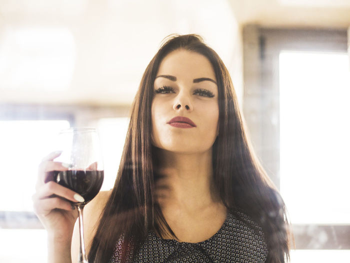 Portrait Of Beautiful Young Woman With Drinking Glass