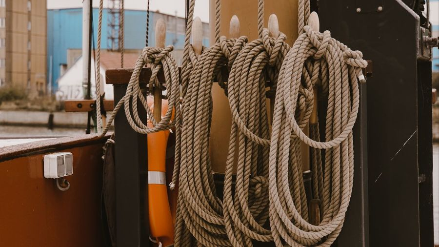 Close-up of rope tied on metal