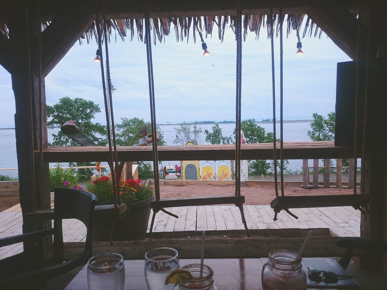 window, table, indoors, no people, day, balcony, sky, tree, home interior, architecture, nature, drink