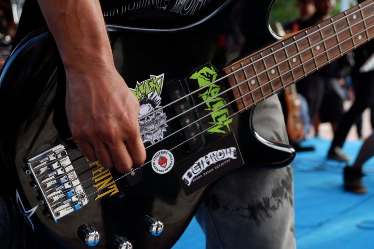 Music Human Hand Human Body Part Musical Instrument Performance Electric Guitar Musician Popular Music Concert Close-up People Only Men Arts Culture And Entertainment Outdoors Day