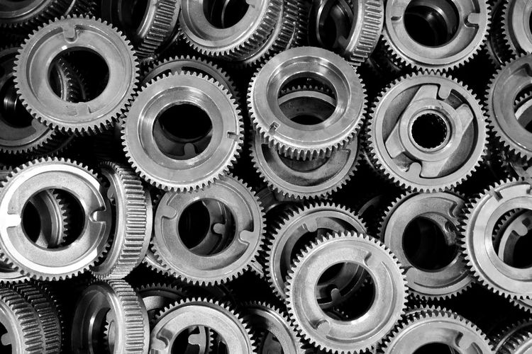 engine gear wheels, industrial background Alloy Aluminum Backgrounds Close-up Complexity Connection Cooperation Equipment Full Frame Gear Indoors  Industry Large Group Of Objects Machine Part Machinery Metal No People Silver Colored Still Life Studio Shot Teamwork Technology Wheel