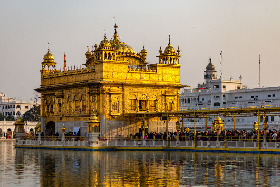 The Golden Temple, Harmandir Sahib, glowing at sunset in Amritsar, India Amritsar Architecture City Evening Famous Place Glow Glowing Gold Golden Golden Color Golden Temple Harmandir Sahib India Lake Monument Punjab Sikh Sikh Temple Sikhism Sunset Temple Tourist Attraction  Travel Destinations