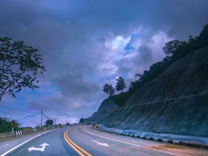 street Streetphotography Street Road Mountain Winding Road Speed Awe Dramatic Sky City Sky Landscape Cloud - Sky Empty Road Highway Car Point Of View Tail Light Two Lane Highway Vehicle Light Overpass Mountain Road Multiple Lane Highway