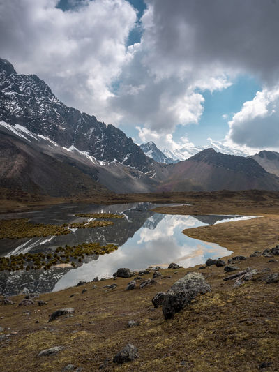 Peru Reflection Clouds And Sky Hiking Wilderness Water Mountain Snow Lake Sky Landscape Mountain Range Cloud - Sky Snowcapped Mountain Mountain Peak Rocky Mountains Geology Rock Formation Glacier This Is Latin America
