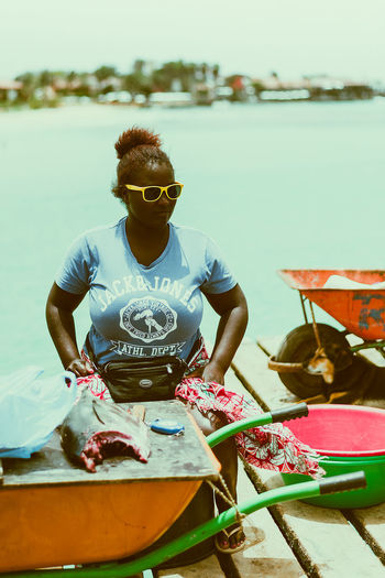 Fish market fashion Colourful Fashion Tuna Market Africa Blue Coulours  Day Fish Fish Market Front View One Person Outdoors People Real People Sea Sitting Sunglasses Water Young Adult