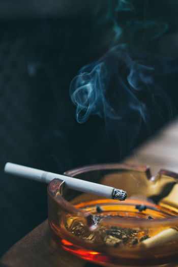 Close-up of cigarette in ashtray