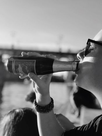 Drink. Real People Focus On Foreground Lifestyles One Person Women Day People EyeEm Portrait Eyeemhuman EyeEmPortraits France Cool Beautiful Day Young Adult Black And White Friday