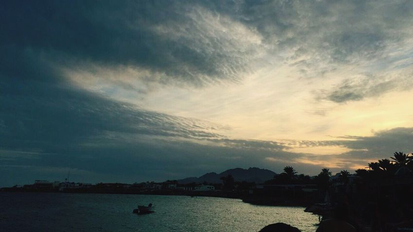 Sunset at Sharm Al Sheikh Cloud - Sky Sky Water Nature Nautical Vessel Beauty In Nature Outdoors Silhouette Scenics Sunset No People Sea Tranquility Building Exterior Architecture Day Tree Egypt Dahab Sharm El-Sheikh