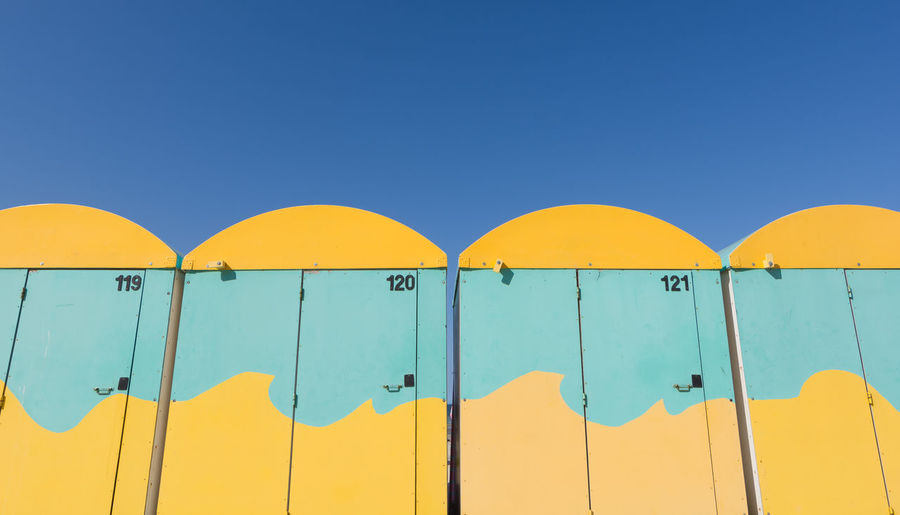 Yellow waves. Dunkerque, France Beach Cabins Blue Blue Sky Clear Sky Colorful Conformity Contrast Dunkerque Beach France 🇫🇷 In A Row Multi Colored Number Side By Side Vibrant Color Yellow Yellow Color Yellow Waves TakeoverContrast Sommergefühle Paint The Town Yellow