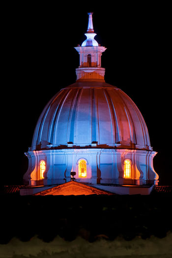 The dome of a church in Popayan, Colombia lit up at night time. America Architecture Blue Building Cathedral Catholic Christian Christianity Church City Colombia Dome Downtown Faith Historic Light Night Old Park Pink Plaza Popayán Religion Religious  South