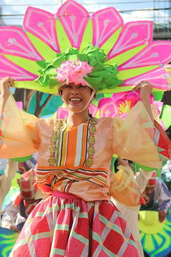 Woman with multi colored umbrella
