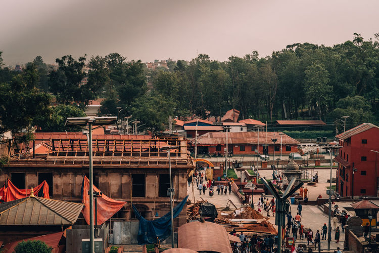 Religious Architecture Pashupatinath Premises Architecture Building Building Exterior Built Structure Construction Equipment Day Growth House Nature No People Outdoors Plant Roof Sky Tree Water The Street Photographer - 2018 EyeEm Awards Tiled Roof  Historic