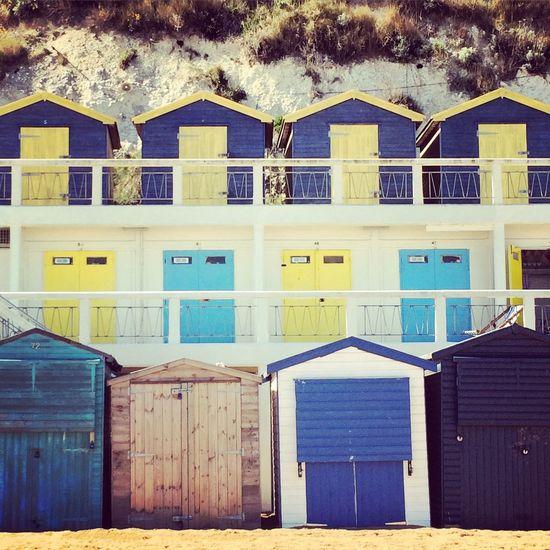 Broadstairs BeachHouse Coloursheme Pattern Row Yellowandblue Wooden Beach Huts Rocks Seaside