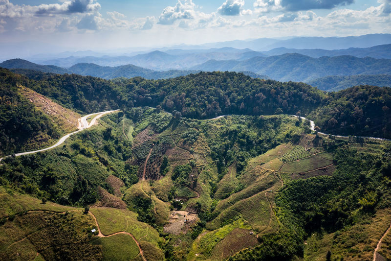 Aerial view landscape mountain valley and over road abstract background from drone camera