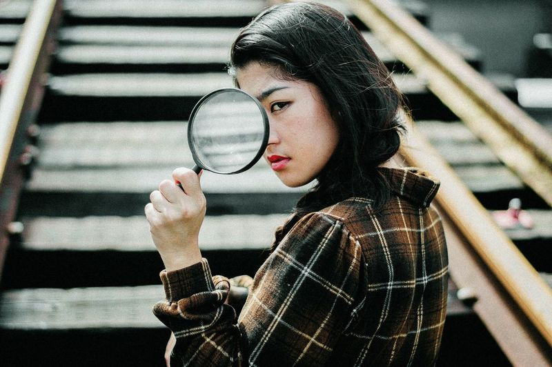 Showcase July The Week Of Eyeem Portrait EyeEm Best Shots EyeEm Girl Close-up Relaxing Magnifying Glass See Photography Hanging Out EyeEm Gallery Portrait Of A Woman Railway