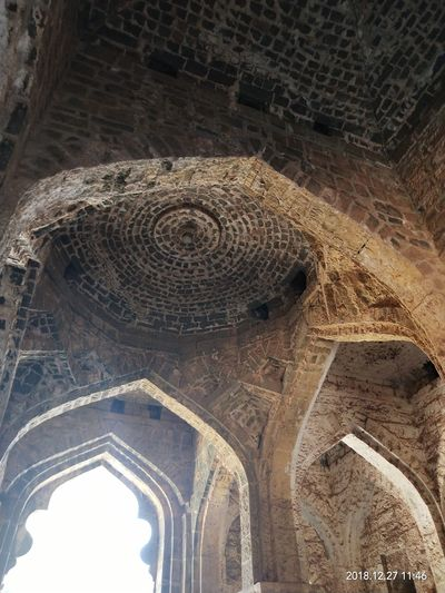 Low angle view of old ceiling of building