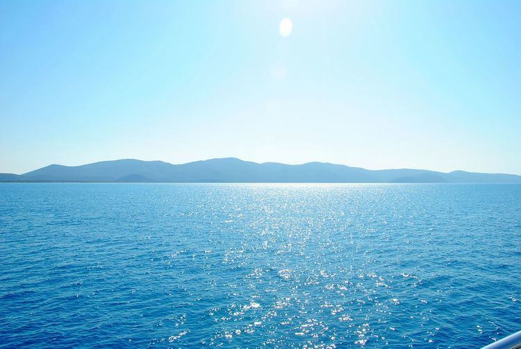 Clear Sky Blue Scenics Beauty In Nature Water Landscape Outdoors Nature Tranquility Sky No People Mountain Day Sea And Sky EyEmNewHere Beauty In Nature Sunlight Nature Sea Italia Italy Clear Sky Nautical Vessel Passenger Ship Freshness EyeEmNewHere Miles Away Miles Away