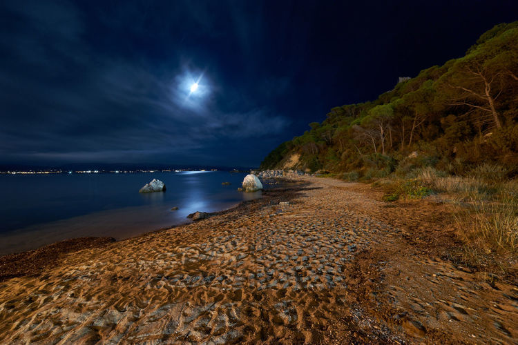 Moon Beach Beauty In Nature Cloud - Sky Horizon Over Water Idyllic Land Moonlight Nature Night No People Non-urban Scene Outdoors Reflections Rock Rock - Object Sand Scenics - Nature Sea Sky Solid Tranquil Scene Tranquility Water My Best Travel Photo My Best Photo 17.62°