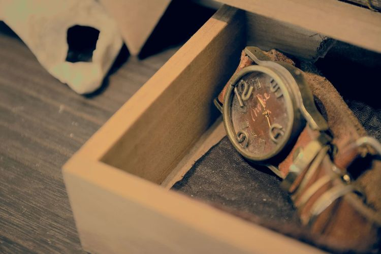 High angle view of antique watch in wooden box at shop