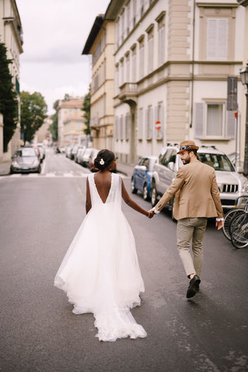 Full length of couple on road