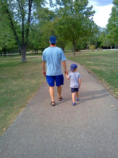 Father and son walking holding hands Dad And Son Father & Son Family Walks Daddy And Son Father And Son Getting Inspired Enjoying Life Walking Around EyeEm Best Shots Relaxing Hand In Hand Holdinghands Walk Father's Day Fathers Day Hats Blue Two Color Kids Family Family Time Walk In The Park Walking Walk This Way