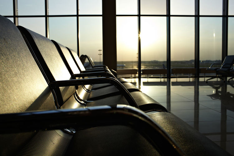 Airport Bench Chairs Dark Design Hall Indoor Inside Interior Light Lounge Modern No People Photo Sun Sunrise Sunset Transport Tv Windows