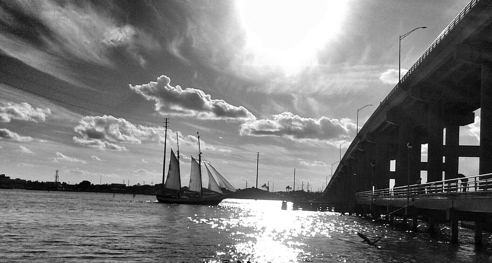 Sailing home. Fort Pierce South BridgeSailboat Sailing Sailing Boat Travel Destinations Outdoors Reflection Romantic Scenery Black And White Photography Sailing Yacht EyeEmNewHere Fort Pierce, FL