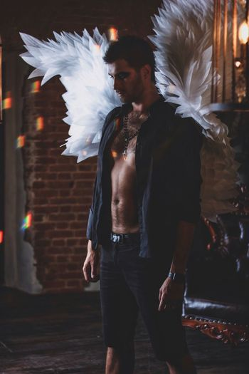 Real People One Person Three Quarter Length Standing Front View Leisure Activity Men Young Men Lifestyles Costume Wing Architecture Young Adult Adult Motion Males  Casual Clothing Night Shirtless Angel Jeans
