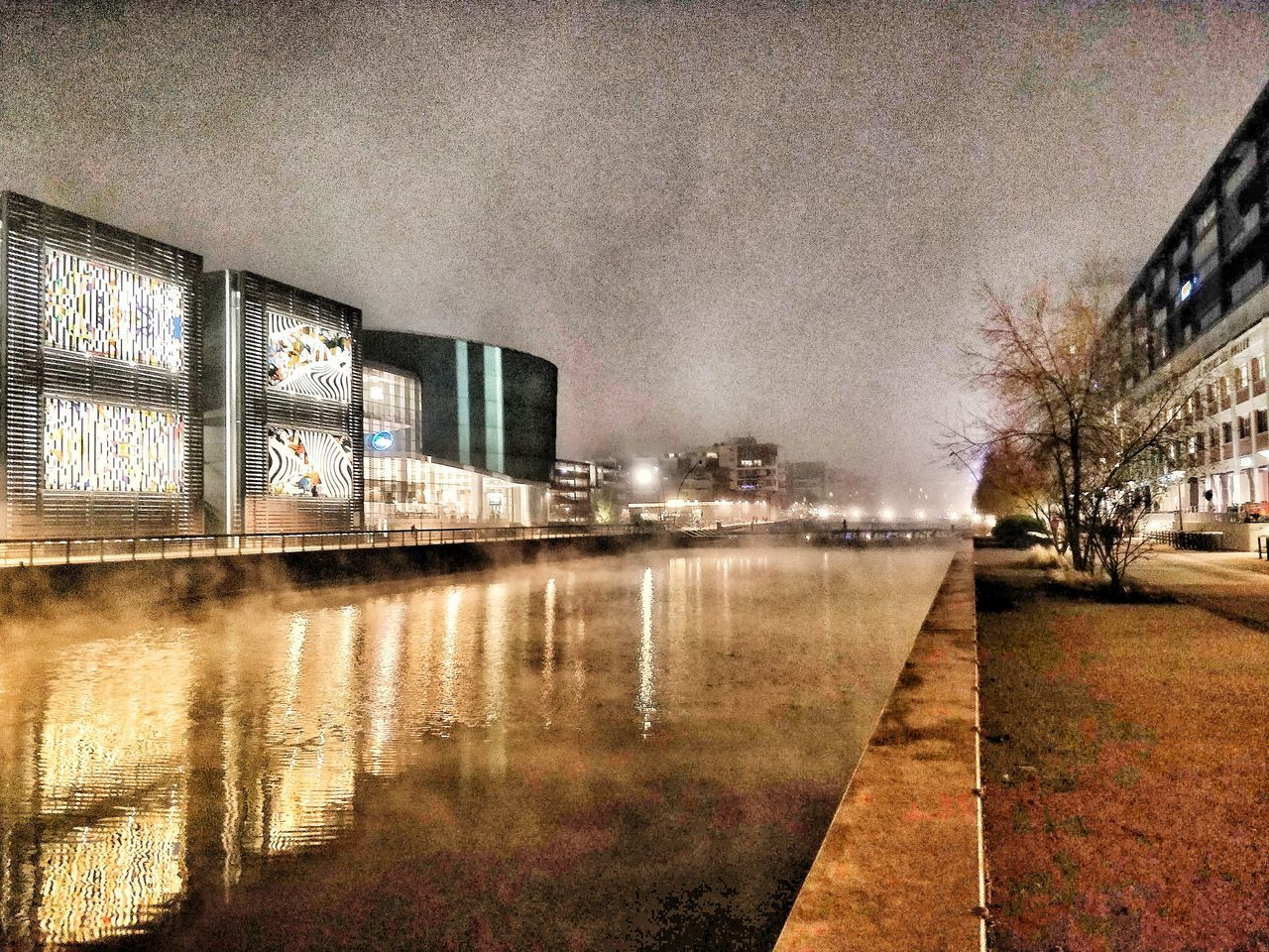 architecture, building exterior, reflection, built structure, water, city, illuminated, sky, nature, tree, no people, building, street, wet, night, outdoors, bare tree, plant, rain, glass, canal