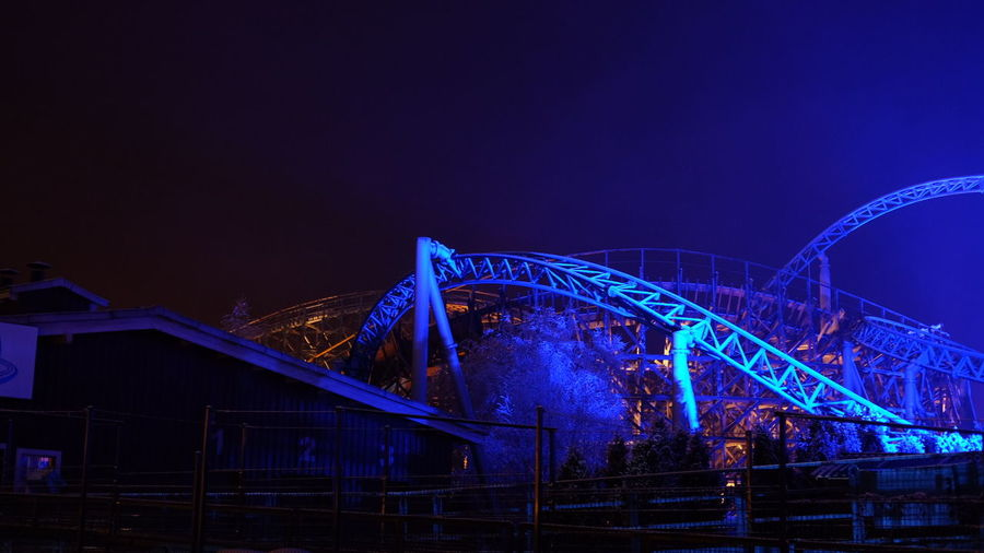 Night Bridge - Man Made Structure Blue Illuminated Speed Motion Built Structure Architecture Outdoors No People Sky Rollercoaster Roller Coaster Blue Fire Europapark Europa Park Park Parc Steel Structure  Steel Colors Colorful Lamplight Europapark Rust Lamp