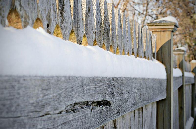 Snow covered wooded bridge