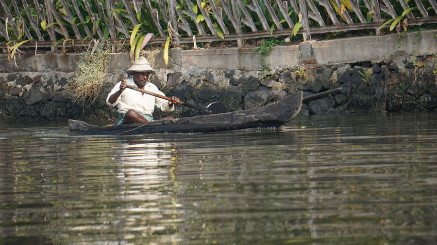 Hardwork Strive To Achieve Struggle To Earn Bread Beauty In Ordinary Things Poor People  Life Through My Eyes Life As I Know It Work In Hot Weather Modern Workplace Culture Water Nautical Vessel Full Length Tree Oar River Men Fishing Net Paddling Fisherman Fishing Boat