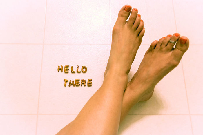 Alphabet Bizarre Communicate Feet Female Floor From Where I Stand Greeting Hello Hi Message Painted Toenails Part Of Personal Perspective Perspective Pretzels Quirky Toe Ring Toes Uncommon  Unique Whimsy Woman
