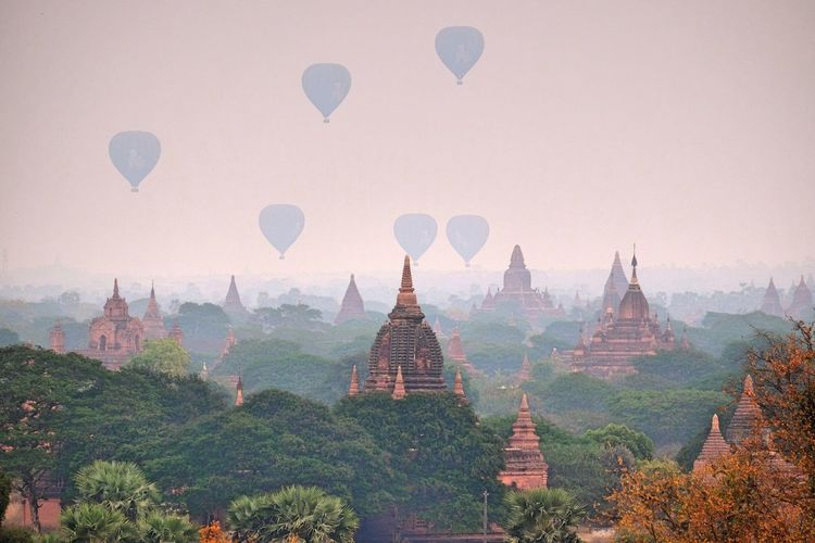 Hot air balloons flying over bagan archaeological zone