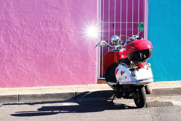 Sunlight Transportation Sunny Outdoors Day Shadow Mode Of Transport Land Vehicle Built Structure Helmet Full Length Architecture Scooter Bike Sunstar Colorful Lines Street Wall Street Photography EyeEm Best Shots Check This Out in Bo-kaap Cape Town , South Africa MISSIONS: The Street Photographer - 2017 EyeEm Awards The Architect - 2017 EyeEm Awards Neon Life Mix Yourself A Good Time The Creative - 2018 EyeEm Awards
