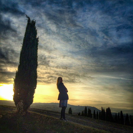 Sky Cloud - Sky Sunset One Person Standing Nature Lifestyles Land Real People Beauty In Nature Leisure Activity Field Women Scenics - Nature Full Length Plant Young Adult Tranquility Outdoors Hairstyle Teenager