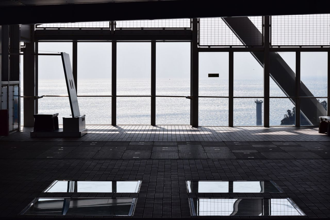 architecture, water, built structure, sea, no people, day, window, sky, railing, nature, indoors, glass - material, reflection, horizon over water, horizon, transparent, transportation