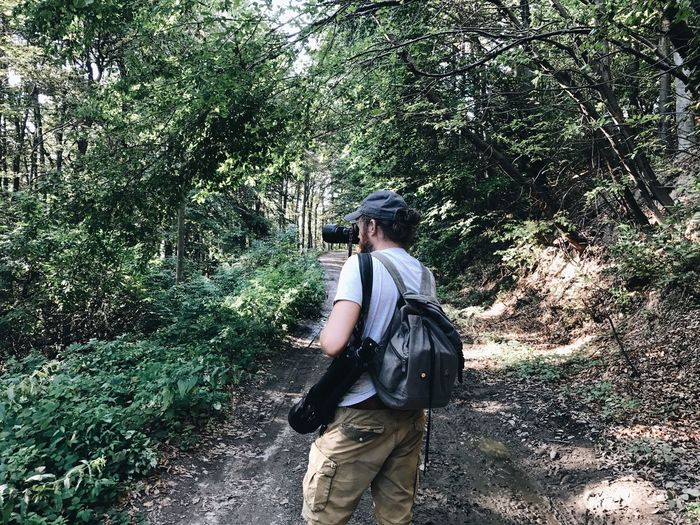 Tree Hiking Backpack Forest Real People Nature Walking Beauty In Nature Day Outdoors Growth One Person Leisure Activity Tranquility Men Standing Full Length Young Adult People Adult