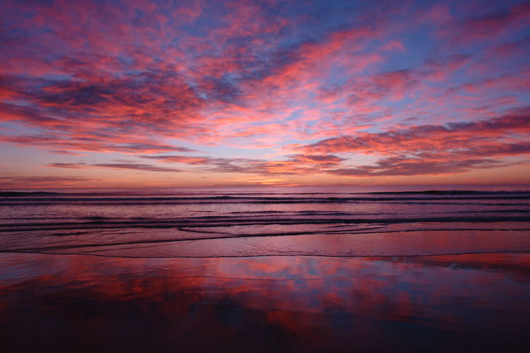 Water Sky Sunset Sea Tranquility Scenics - Nature Reflection Beauty In Nature Cloud - Sky Tranquil Scene Horizon Horizon Over Water Nature Dramatic Sky No People Orange Color Land Beach Idyllic Outdoors Romantic Sky Saturated Color