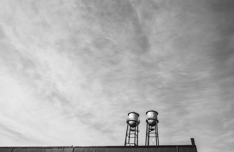 Low Angle View Of Water Tanks On Building Against Sky