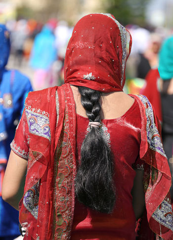 Indian woman Indian woman with red dress and long black hairwith dress and long black hair Baisakhi Females India Indian Sikhi Woman Baisakh Girl Kirtan Nagar Nagar Kirtan Nagarkirtan  Parade People person Religion Religious  Rite Sikh Sikh People Sikh Religion Sikhism Sikhlife Sikhs Vaisakhi