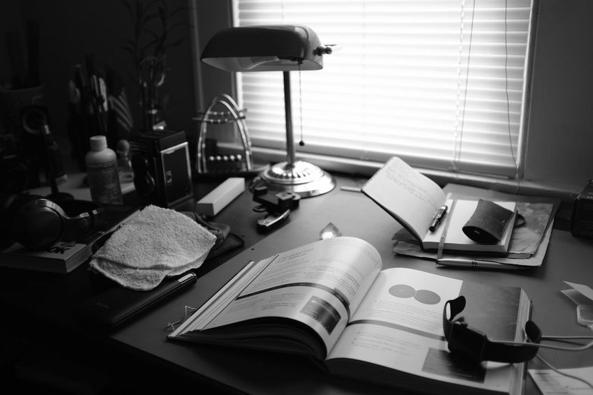 Quiet Study Moments Absence Book Day Desk Domestic Room Education Electric Lamp Furniture Home Interior Indoors  No People Open Paper Publication Still Life Table Technology Window