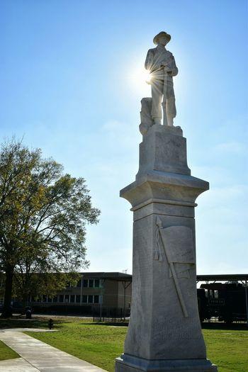 Main Street Ornate Shadow Silhouette Bright Sun Lighted Memorial Statue